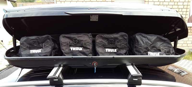 Thule Taschen passen perfekt in die Dachbox